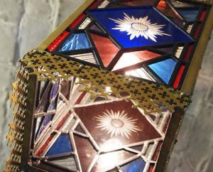 blue and red stained glass lampshade with brass edges