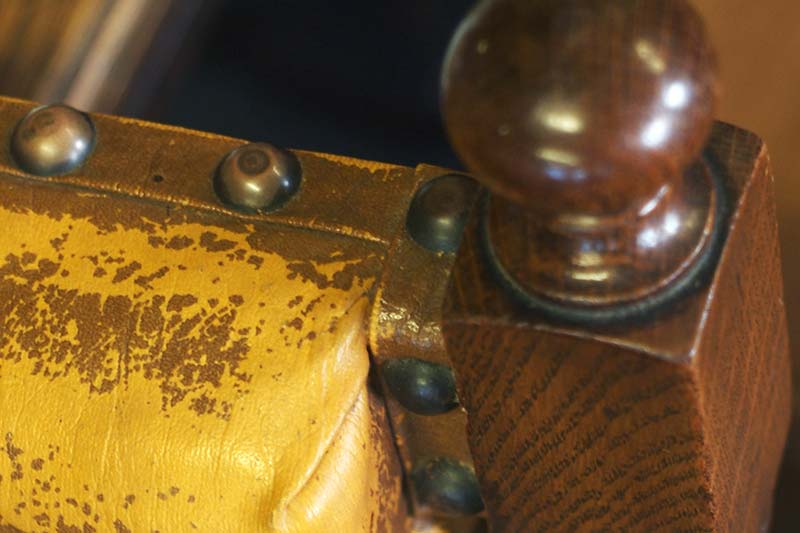 close up of an old wooden chair in need of restoration