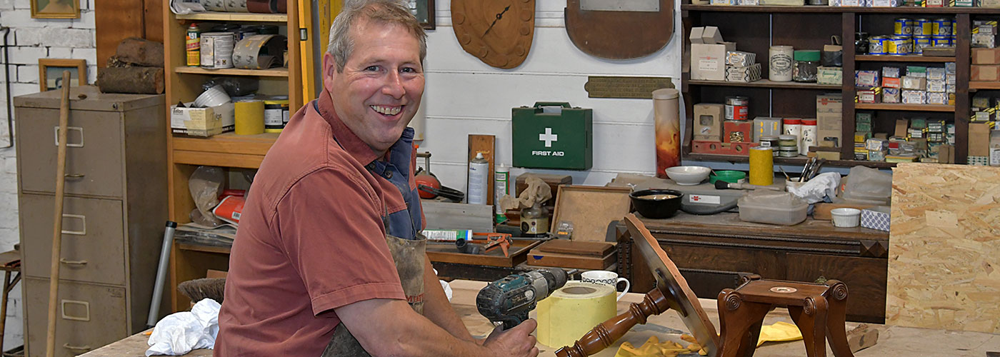 Graham Sparks working at his woodworking bench at his workshop