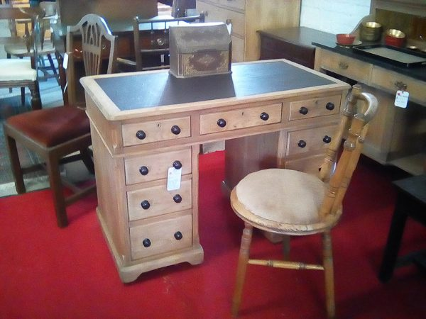 Antique pine desk with leather top and 9 drawers